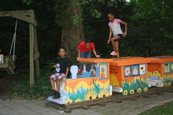 children on toy train