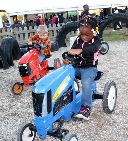 children on toy tractors